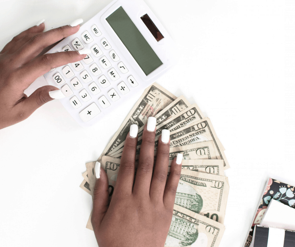 calculator with money and hands to make money blogging