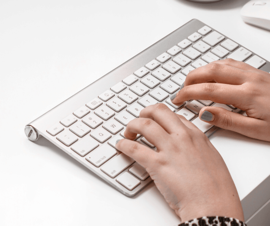 Typing hands on a keyboard narrowing a blog niche